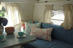 Get Campie — vintage trailers — 1961 Shasta compact interior....love the pom pom trim on the curtains!