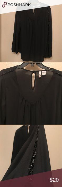 Designer Sami Jo Black Blouse Sami Jo Black Blouse with sequined sleeves- none Missing excellent condition- Designer Sami jo- BCBGMaxAzria Tops Blouses