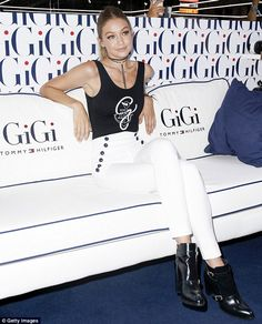 Star power: Gigi posed on a sofa with her name emblazoned on it as she promoted her new fashion line