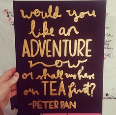 Handpainted canvas with the quote, Would you like an adventure now, or shall we have our tea first? -Peter Pan. Item shown is white with gold lettering, but any color combo is available