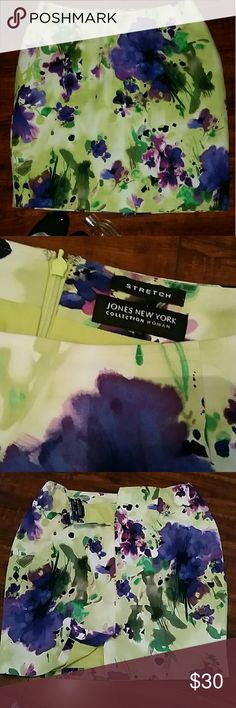 Water colored skirt JNY Beautiful bright colors in this pencil skirt from Jones New York Collection. Fabulous pattern in greens, blues and purple  Size 14W,  stretch cotton spandex material Back zipper and kick pleat  Fully lined in matching green lining  22 inches long Jones New York Skirts Pencil