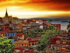 Visit Chile. Isabel Allende made me fall in love with the idea of Chile in her stories!  Valparaíso, Chile