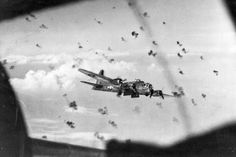 What my Dad witnessed as the tailgunner in the B-17. Uploaded by, and caption by Cheryl Mollison. An amazing photo. Each one of those puffs of cordite if on target would most likely seal the fate of the aircraft.