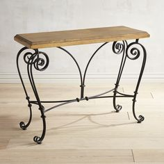 With a flirty yet graceful demeanor and a handsome yet traditional elegance, our console table is evidence that a split personality can be a good thing. The intricately scrolled legs and base are made of hand-forged wrought iron and support a nicely finished mango wood top. Perky enough to stand out yet coy enough to mingle easily with your other furnishings, this table will be good therapy for your home.