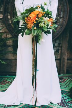 orange and green bouquet with cascading ribbons - photo by Indestructible Factory http://ruffledblog.com/tropical-mid-century-modern-wedding-inspiration-with-spanish-flair