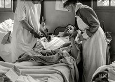 """June 12, 1918. """"Dressing the wound. American Military Hospital No. 1 at Neuilly, France (Dr. Johnson)."""""""