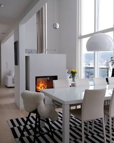 We would cozy up to that fireplace in an instant! Rta Cabinets, Light My Fire, Scandinavian Interior, Home Kitchens, House Plans, Sweet Home, Dining Table, Room Decor, Cozy