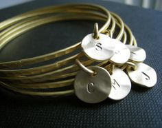 set of 8 gold bangles with initial disc charm by NYmetals on Etsy, $85.50