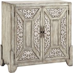 Featuring elegant filigree door panels, this charming cabinet adds a touch of country-chic style to your entryway or office.Produc...