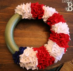 This was so easy and turned out fantastic! Total cost less than $30! BONUS!!!  Capital B: Ruffly Patriotic Wreath Tutorial