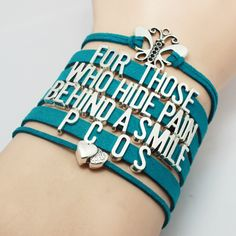 """""""For Those Who Hide Pain Behind A Smile"""" Teal PCOS Awareness Bracelet. You will get the same bracelet as the pictures, and the charms are antique silver, this is a very good choice to give as a gift t"""