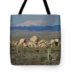 Big Boulders And Saguaros East Of Florence Tote Bag by Tom Janca.  The tote bag is machine washable, available in three different sizes, and includes a black strap for easy carrying on your shoulder.  All totes are available for worldwide shipping and include a money-back guarantee.