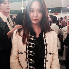 Krystal - The Band: f(x) The Brands: Carven, Iro, Valentino With her sister Jessica Jung of Girls' Generation, Krystal represents Seoul's more demure street-style contingent: floral embroidered Valentino minis, baby-doll dresses from Saint Laurent. Though airport style hasn't caught on at Incheon quite like it has at LAX, her uniform of Breton-stripe shirts and trenches with Mulberry satchels has a strong following on Tumblr. The Front-Row Look: A cream bouclé jacket with black trim and Sgt…