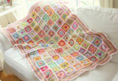 Granny Square crocheted with wool in bright spring colors.