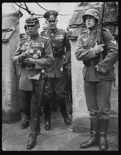 General Erich von Ludendorff, the German soldier, who masterminded the annihilation of the Russians at Tannenberg during the First World War, leaving his home at Tutzing near Munich to inspect troops. He is accompanied by Marshal Von Blomberg, the German Minister of War. 1935