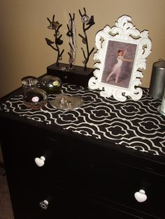 my dresser, mismatching black and white knobs, hand made runner from fabric