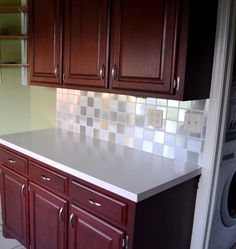 Backsplash made out of contact paper. Great way to spruce up an ugly backsplsh in a rental!