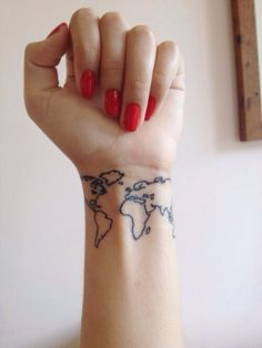 Girl with a tattoo of the outline of the continents on her wrist