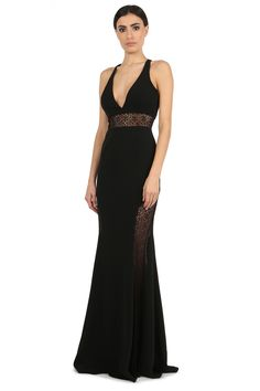 """TENOR DEEP V-NECK LACE PANEL GOWN  $565  THE TENOR REDEFINES SEXY BY PAIRING A SIMPLE GOWN SILHOUETTE AND WITH FEMININE LACEWORK. THE LACE PANELING AT THE WAIST AND AT LEG SIDES ALLOWS FOR THE PERFECT AMOUNT OF SKIN TO SHOW THROUGH. PRODUCT INFORMATION:DEEP V-NECK LACE PANEL GOWN, DETAILS: RACER-BACK, FIT: FITTED THROUGH BODY, CLOSURE: ZIPPER, MATERIALS: STRETCH CREPE & ABSTRACT LACE, CARE: DRY CLEAN ONLY, LINED, IMPORTED. PRODUCT MEASUREMENTS: LENGTH FROM SHOULDER: 65"""", MEASUREMENTS TAKEN…"""