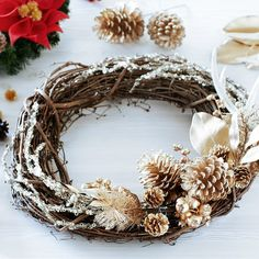 Make this trendy Metallic Antler Christmas Wreath to decorate your home this holiday season