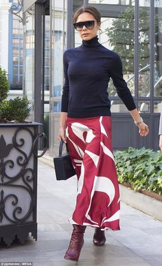 Vibrant: Victoria's statement skirt flowed to the ankle and was emblazoned with a striking...