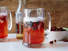Sunny Anderson makes the easiest and tastiest grownup fruit punch ever— and it has beer in it!