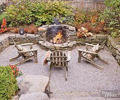A sunken design and rustic flagstone walls ensure that gravel doesn't spill into the adjoining gardens and lawn. The smallish gravel mimics the various colors seen in the stacked stones and the fireplace to generate a pleasingly cohesive composition./