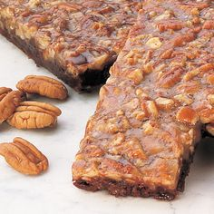 "Caramel . . . Pecans . . . Chocolate ""They taste like a dream."" – WAG Magazine Chocolate Turtle Bars- a decadent layer of creamy caramel, loaded with pecans, baked on top of a dense fudgy brownie. The"