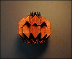 https://flic.kr/p/ayX1G4   Jack O'Lantern - Tachi   Designer: Tomohiro Tachi CP: Jack O'Lantern by tactom Tutorial: Jo Nakashima Youtube Paper: Tant decorated with Starburst Spray and Magical Mica Paint; 32 x 22 grid rectangle  I love corrugations and I love this fun model!