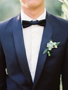 Navy Groom Suite with Green boutonniere and succulent Image by Erich McVey