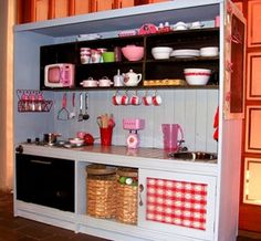 i am loving these play kitchens made from old entertainment centers. I will have to remember this one, for when I get my big house for the grandbabies.