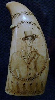 early scrimshaw whale's tooth with a whaling sailor's portrait