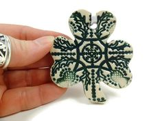 Listing is for one Celtic thistle shamrock ornament. The ornament measures 2 1/2, has a ribbon, and comes in a white gift box.  More Irish decor