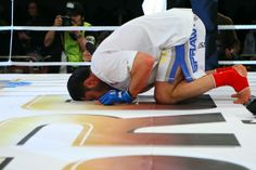 Mamed Chalidow praying after fight. Chechen fighter,representing Poland. Muslim prayer.