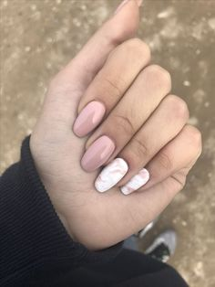 dusty pink nails and two white and dusty pink marble nails that bring a trendy and edgy feel to the look