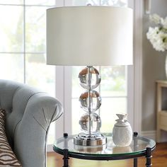 We see beautiful, handcrafted lighting in your future. The base of this lamp is made of three crystal balls—one of this season's hottest silhouettes. The impressive finishing touch: A silky, white cotton drum shade. Table Lamps For Bedroom, Living Room Furniture, Living Room Decor, Bedroom Decor, Bedroom Ideas, Unique Lamps, Bedside Lamp, Interior Exterior, Drum Shade