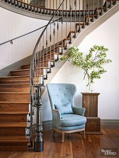 This wrought-iron staircase railing makes a sculptural statement that originates with its floor-set newel post. A curving rail and beautifully detailed balusters held in place by decorative brackets combine for a fabulous focal point. The simply lined handrail on the inner wall ensures safe passage for pairs traveling the stairs at the same time.