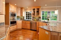 Beautiful high-end kitchen in light wood. You must see these other great high-end kitchen designs.