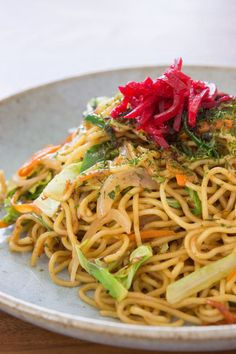 Yakisoba is a classic Japanese street food made by stir-frying boiled ramen noodles, vegetables and meat or seafood with a sweet and savory sauce.