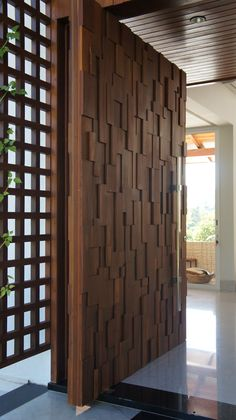 Check out the gorgeous 3-dimensional geometric design on this pivot door in Brazil. Find out more about pivot doors or design your own at http://pivotdoorcompany.com/Exterior-Doors/.