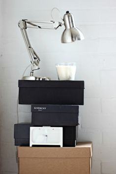 Make your own bedside table with some old shoeboxes - great for tight budgets!