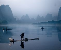 ha long lanterns.  Foggy background with mountains for interest.  Focus object in foreground.