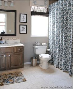 Tall shower curtain... navy shower curtain with green panels on top and bottom to extend for guest bath. White sheet with blue panels on top and bottom for master...?
