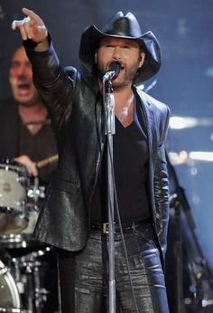 Tim McGraw.He is so hot.Please check out my website thanks. www.photopix.co.nz