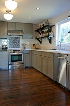 Grey kitchen with exposed shelving.