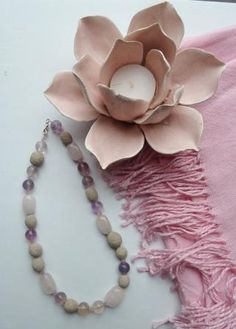 Save your wedding bouquet as beads in a necklace you can wear forever.  This Wedding bouquet necklace was made from light purple and white roses.  See the website for more details.