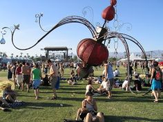"""Cleavage In Space"" by Roseanna Scimecca at Coachella Obviously it's a broken chandelier and since it's broken the electrical has gone awry . if you touch it . you will get a little shock. Has Gone, Installation Art, Coachella, Discovery, The Past, Scale, Chandelier, Skyline, Horses"