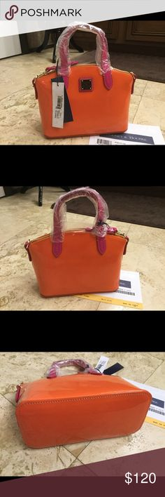 Dooney & Bourke clementine  Ruby New never used orange patient leather with pink leather straps cross body strap plenty of room for wallet phone and goodies 10 1/2 by 7 inch tall wide mouth easy zipper gold tone gold logo on front super cute for summer on the go. comes with registration card ☺️ Dooney & Bourke Bags Mini Bags