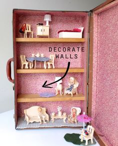 Using an old style suitcase to make a portable dollhouse.  I like how it can be self contained and is easy for kids to carry.