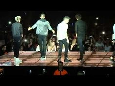 Liam and Harry doing the worm tonight in Liverpool TMH 2013  but LMAO at Niall's attempt....like a fish out of water